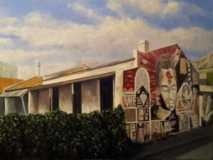 Painting of a building in Woodstock, Cape Town, covered in street art