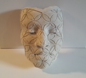 """Atlantean Mask"" wall-mounted sculpture in cast cement"