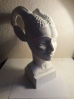 Sculpture of head representing ancient human legends of the horned god