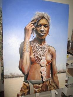 Portrait of an Angolan girl with a badger pelt headdress