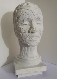 """Atlantean Head"" sculpture cast in white cement"