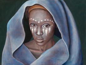 Portrait of beautiful Malawian woman draped in blue shawl